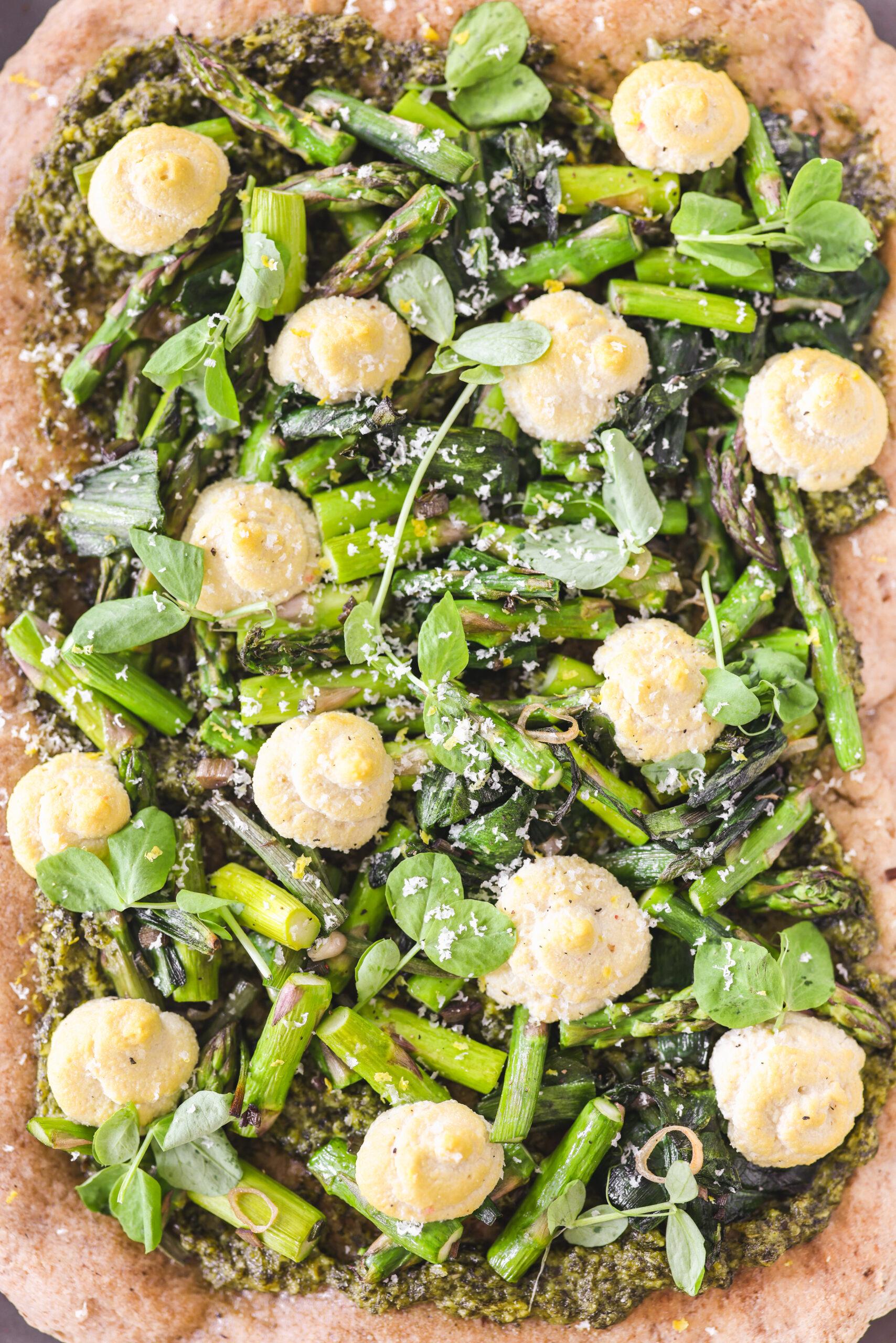 Asparagus ricotta and pea shoot pesto pizza